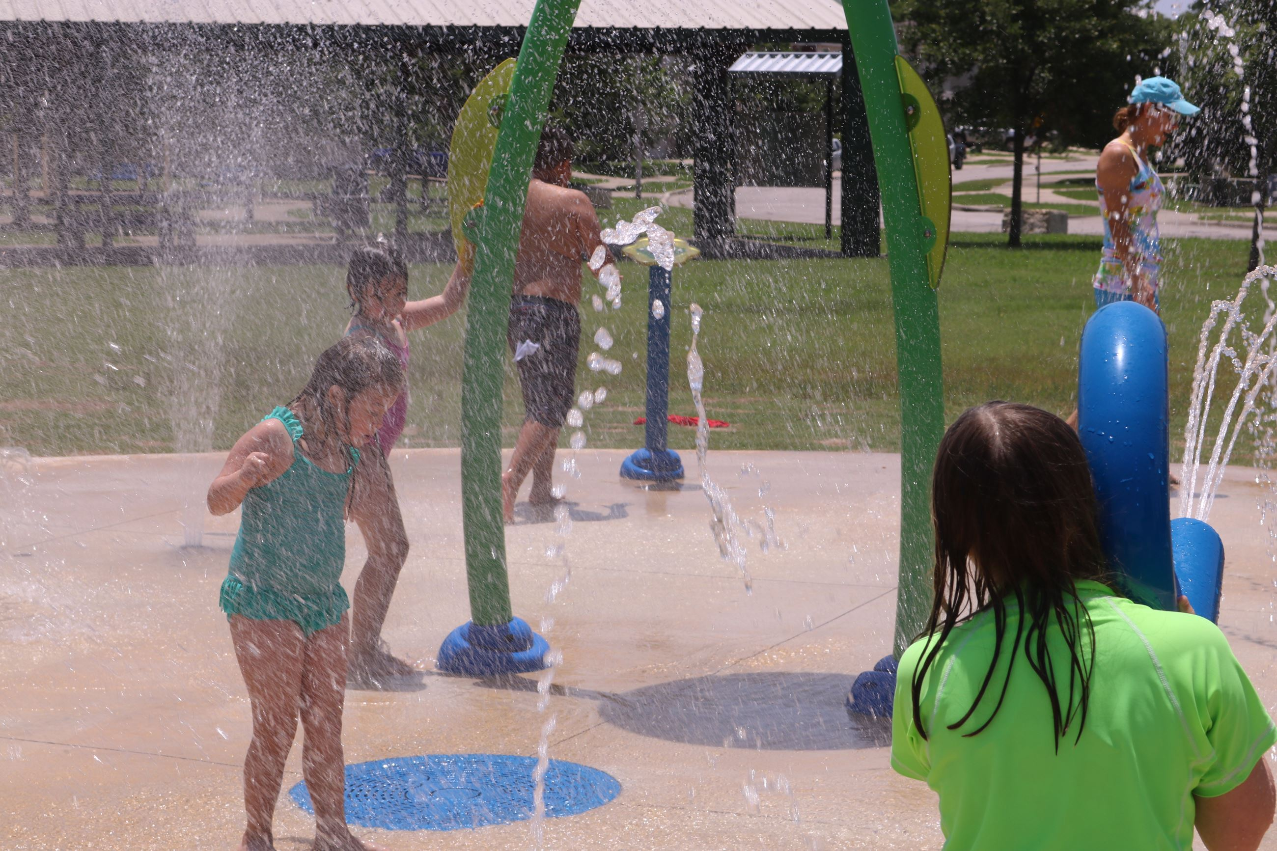Shows Green Meadows Splash Pad With Kids Playing